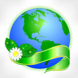 Postcard on April 22 - Earth day. Globe with green ribbon and flower Stock Images