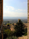 Postcard from Assisi. Almost sunny day in Assisi (Umbria, Italy) with a glimpse to a beautiful landscape Royalty Free Stock Photos