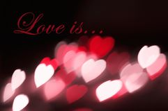 Postcard background hearts bokeh effect Love is Stock Photography