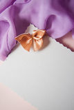 Postcard with beige bow Royalty Free Stock Photos