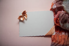 Postcard with beige bow Stock Photos
