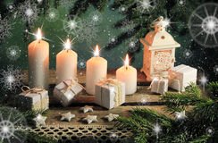 Postcard with candles and gifts. Abstract Xmas composition with  stars and snowflakes Stock Image