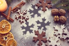 Postcard Christmas cookies in the form of flakes, decorated with dried orange, cinnamon sticks and anise, the background is sprink stock photography