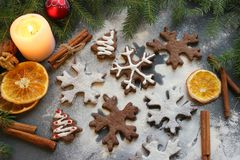 Postcard Christmas cookies in the form of flakes, decorated with dried orange, cinnamon sticks and anise, the background is sprink royalty free stock image