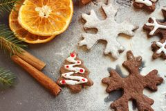 Postcard Christmas cookies in the form of flakes, decorated with dried orange, cinnamon sticks and anise, the background is sprink stock photos
