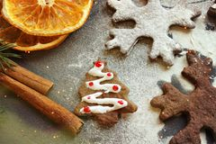 Postcard Christmas cookies in the form of flakes, decorated with dried orange, cinnamon sticks and anise, the background is sprink royalty free stock photography