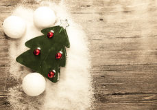 Postcard with a Christmas tree ,Christmas balls snowballs and snow on wooden background Stock Photography