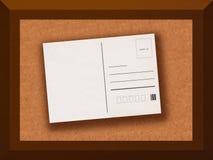 Postcard on cork table Stock Photography