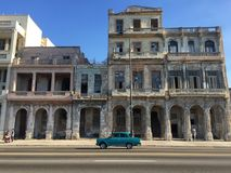 Postcard from Cuba, Malecon. Vintage car and old buildings on the Malecon in Havana, Cuba Stock Photos
