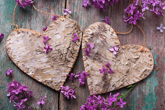 Postcard with decorative hearts and lilac flowers Royalty Free Stock Image
