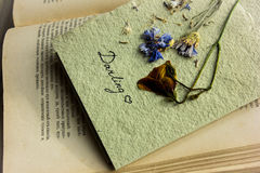 Postcard from dried flowers on an old book Royalty Free Stock Photos