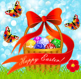 Postcard with Easter eggs in the basket on the mea Stock Photo