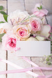 Postcard with elegant  flowers and empty tag for your text Stock Photography