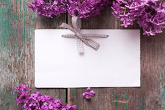 Postcard with elegant lilac flowers and empty tag for text Royalty Free Stock Images