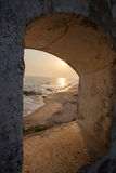Postcard from exotic vacation. Beach and sea from window in the castle Royalty Free Stock Images