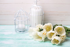 Postcard with fresh spring tulips and daffodils and candles on t Royalty Free Stock Photo