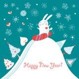 Postcard funny rabbit. Postcard funny white rabbit on a snowy mountain Royalty Free Stock Photo