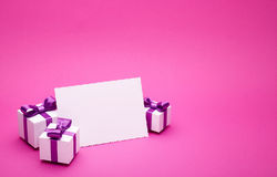 Postcard and gifts on pink background Royalty Free Stock Images