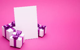 Postcard and gifts on pink background Stock Photography
