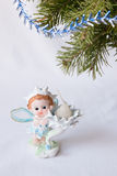 Postcard greetings happy New year, magic elf, fir branch, candle holder, Christmas gifts under the tree, the angel candle, on a wh Stock Photos