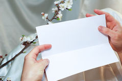 Postcard in hand template Royalty Free Stock Image