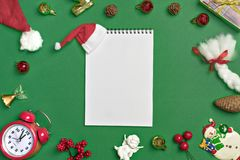 Postcard Happy New Year Flat lay composition with scroll and Christmas decor on green color background. Concept Letter for Santa Claus Greeting Top view Copy royalty free stock photography
