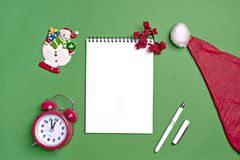 Postcard Happy New Year Flat lay composition with scroll and Christmas decor on green color background. Concept Letter for Santa Claus Greeting Top view Copy royalty free stock photo