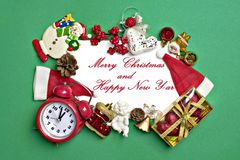 Postcard Happy New Year Flat lay composition with scroll and Christmas decor on green color background. Concept Letter for Santa Claus Greeting Top view Copy stock photos