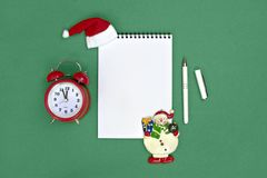 Postcard Happy New Year Flat lay composition with scroll and Christmas decor on green color background. Concept Letter for Santa Claus Greeting Top view Copy stock images
