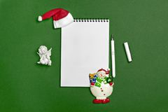 Postcard Happy New Year Flat lay composition with scroll and Christmas decor on green color background. Concept Letter for Santa Claus Greeting Top view Copy stock photo