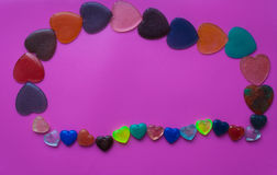 Postcard with hearts for Valentine`s Day. Hearts of epoxy resin. Pink background. Valentine`s Day postcard Royalty Free Stock Photos