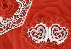 Postcard for the holiday Red roses on a white carved napkin. Valentine`s Day. Close-up. Nature Stock Photo