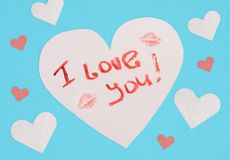 Postcard with an inscription I love you. Lipstick text. Love note royalty free stock images