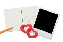 Postcard, instant photo frame and red hearts Stock Images