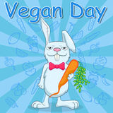 Postcard  for the international day of vegetarian , funny rabbit holds a carrot on a blue background with vegetables, a call to be Royalty Free Stock Image
