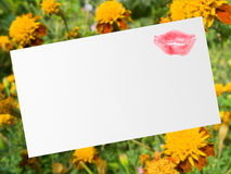 Postcard with kiss. Postcard (paper texture) with kiss, flowers on background Stock Image