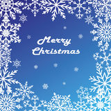 Postcard Merry Christmas. Winter pattern of snowflakes on a blue background. Vector Royalty Free Stock Photography