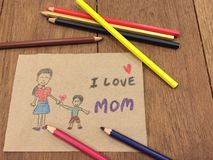 Postcard for my mom. Little boy love letter written to his mother Royalty Free Stock Photography