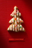 A postcard with a picture of a cookie Christmas tree Royalty Free Stock Photos