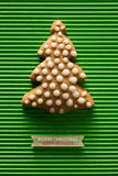 A postcard with a picture of a cookie Christmas tree Royalty Free Stock Photography