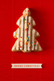 A postcard with a picture of a cookie Christmas tree Royalty Free Stock Images