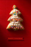 A postcard with a picture of a cookie Christmas tree Royalty Free Stock Image