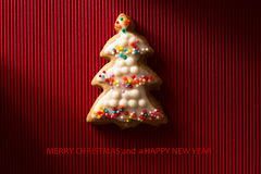 A postcard with a picture of a cookie Christmas tree Stock Image