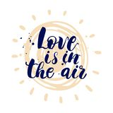 Postcard or poster with hand drawn lettering. Love is in the air. Vector illustration. Stock Photography