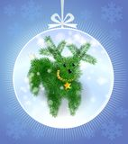 Postcard  puppy of Christmas tree. Postcard to the new year with the symbol of the year of the dog in the form of a puppy from Christmas tree branches Royalty Free Stock Photos