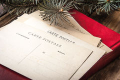 Postcard on the red book with fir tree Royalty Free Stock Images