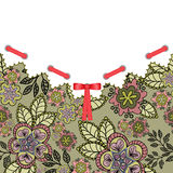 Postcard with a red bow. And floral background sand-colored Royalty Free Stock Photography