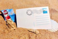 Postcard on a sandy beach. Holiday postcard, at the sandy beach Stock Photography