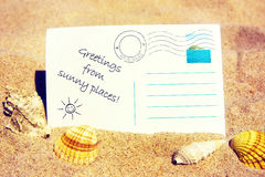 Postcard on a sandy beach. Holiday postcard, at the sandy beach stock photos