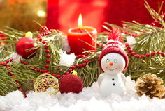 Postcard with snowman and christmas decoration Stock Image